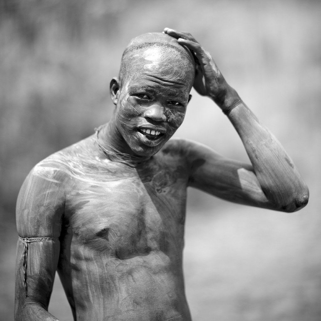 Fluidr body decoration before donga fight in surma tribe for African body decoration