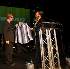 Premier Wall receiving one of Brett Wilson's trademark shirts after he jokingly said that his shirts should have stayed in the 1970s.