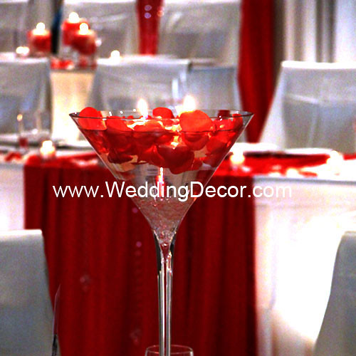 A martini glass vase wedding centerpiece with white crushed glass