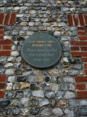 Photo of Ken Johnson grey plaque