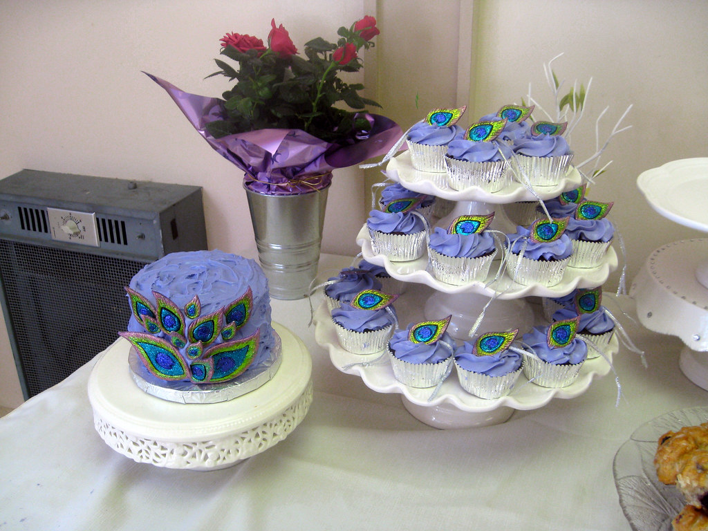 7649dbcd1897 Peacock themed bridal shower cake and cupcakes michelle flickr jpg 1024x768  Peacock themed bridal shower favors