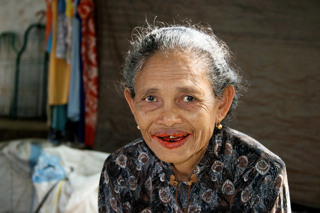 Portrait of an old woman at a market in Indonesia.