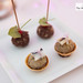 Amuse bouches of foie gras rolled in cocoa nibs and an anchovy tart