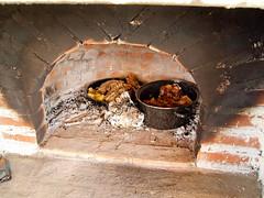 kitchen appliance(0.0), wood(0.0), masonry oven(1.0), hearth(1.0),
