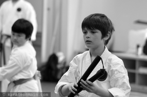 nick, honing his nunchaku skills at a kobudo seminar