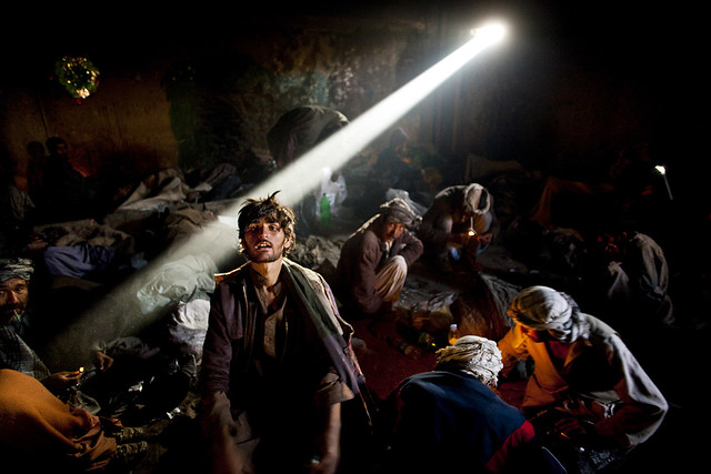 An Afghan addict pauses after mainlining heroin in a Kabul shooting gallery, a single hit of the narcotic costs less than 50 cents, by Benjamin Lowy