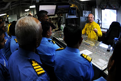 PHILIPPINE SEA (April 8, 2011) Lt. Brian Zimmerman, flight deck officer aboard the aircraft carrier USS Ronald Reagan (CVN 76), explains how flight deck control manages aircraft to Indian naval officers of the Eastern Fleet. Ronald Reagan is participating in Exercise Malabar. (U.S. Navy photo by Mass Communication Specialist 3rd Class Kevin B. Gray)