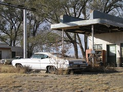 Abandoned gas station, abandoned car