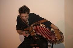 bowed string instrument(0.0), string instrument(0.0), guitarist(0.0), hand drum(0.0), string instrument(0.0), accordion(1.0), folk instrument(1.0), bandoneon(1.0),