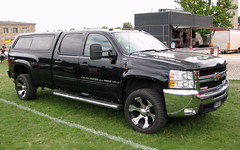 truck(0.0), chevrolet(1.0), automobile(1.0), automotive exterior(1.0), pickup truck(1.0), wheel(1.0), vehicle(1.0), chevrolet suburban(1.0), chevrolet silverado(1.0), bumper(1.0), land vehicle(1.0), luxury vehicle(1.0),