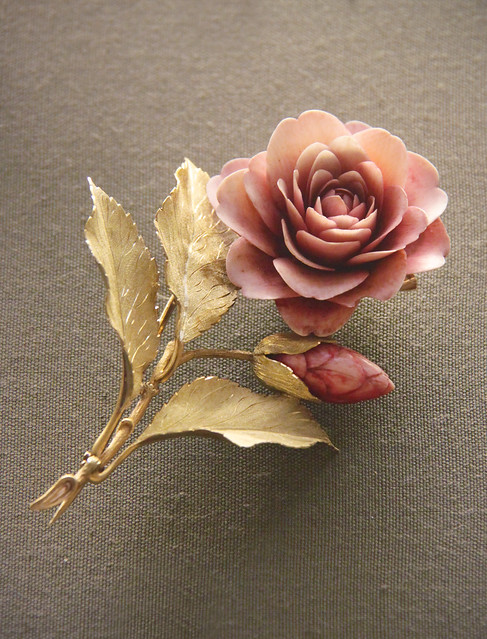 Camellia spray with carved and tinted ivory petals and coloured-gold leaves, English, 1840-50
