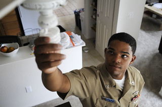 Sailor switches his lights to high efficient bulbs as part of an energy conservation initiative in Hawaii