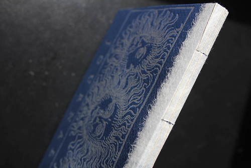 Handmade book cover with spine sewing