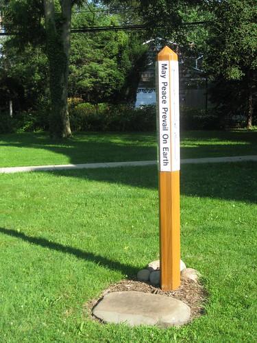 Peace Pole and shadow: Huntington UU
