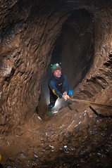 Phill climbing the Sump 11 by-pass Image