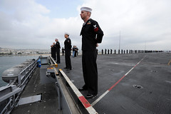 SAN DIEGO (March 19, 2011) Sailors assigned to the aircraft carrier USS Abraham Lincoln (CVN 72) man the rails as the ship pulls into San Diego. The Abraham Lincoln Carrier Strike Group stopped in San Diego on its way home to Everett, Wash., following more than six months deployed in the U.S. 5th and 7th Fleet areas of responsibility supporting maritime security operations and theater security cooperation efforts. (U.S. Navy photo by Mass Communication Specialist 2nd Class Seth Clarke)