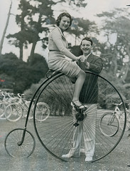 A couple with a penny Farthing in 1930's