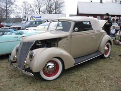 compact car(0.0), automobile(1.0), automotive exterior(1.0), 1937 ford(1.0), wheel(1.0), vehicle(1.0), antique car(1.0), sedan(1.0), vintage car(1.0), land vehicle(1.0), motor vehicle(1.0),