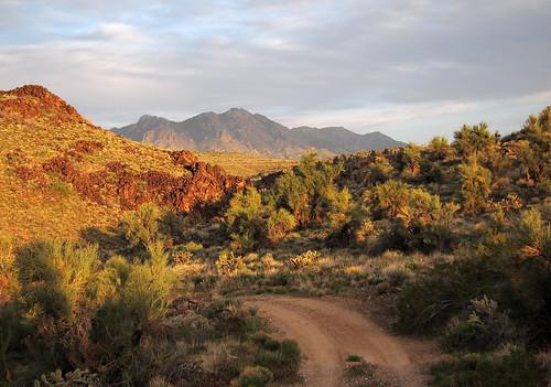 road sunset arizona mountains geotagged rocks day desert cloudy peak boulders dirt mojave hayden aspen kingman hualapai cerbat geo:lat=3515980524 geo:lon=11401898769
