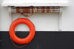 furniture(0.0), wood(0.0), number(0.0), electrical wiring(0.0), iron(0.0), white(1.0), red(1.0), lifebuoy(1.0), circle(1.0),