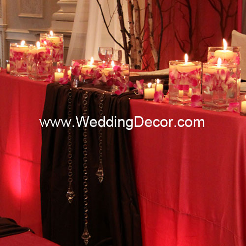 Head table decorations for a wedding reception in fuchsia and brown with
