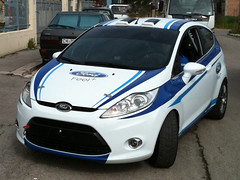 world rally car(0.0), automobile(1.0), automotive exterior(1.0), supermini(1.0), vehicle(1.0), city car(1.0), bumper(1.0), ford(1.0), ford fiesta(1.0), land vehicle(1.0), hatchback(1.0),