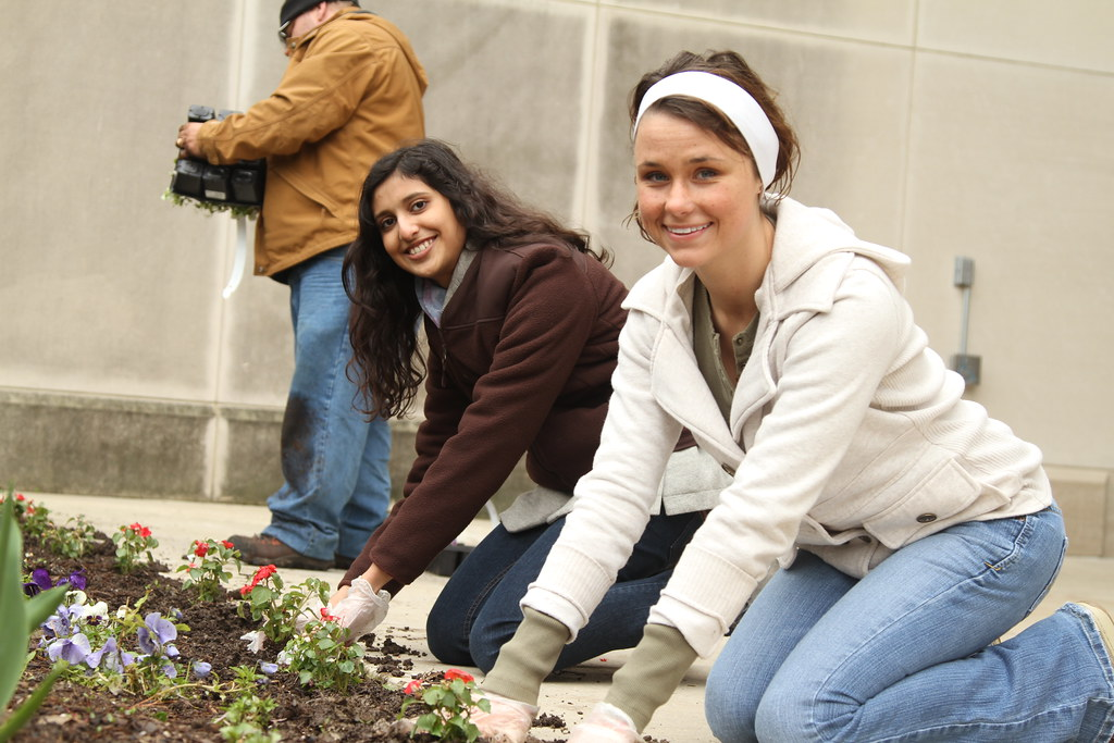 Psychology Club President Amie Huntley (right) helps beautify the IU Kokomo campus