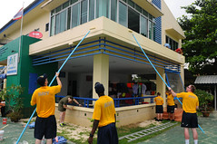 THALANG PHUKET, Thailand (May 4, 2011) Sailors and Marines assigned to the aircraft carrier USS Ronald Reagan (CVN 76) paint the Youth Football Home school building during a community service project. (U.S. Navy photo by Mass Communication Specialist 3rd Class Kevin B. Gray)