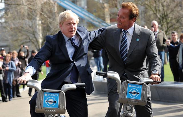 London Mayor Boris Johnson takes former Governor of California Arnold Schwarzenegger for a ride