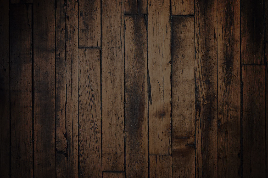 Dark wood paneling with wood floors wood floors for Black hardwood flooring