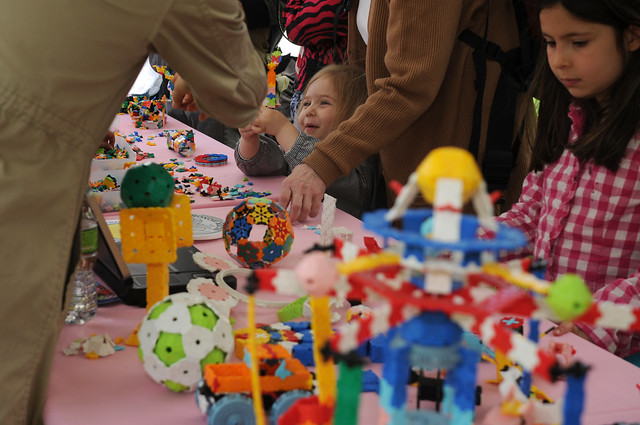 Children play with LaQ, a creative building block. Photo by Mike Ratliff.