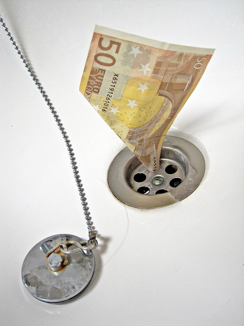 Image of Euro going down the drain from Flickr via Wylio