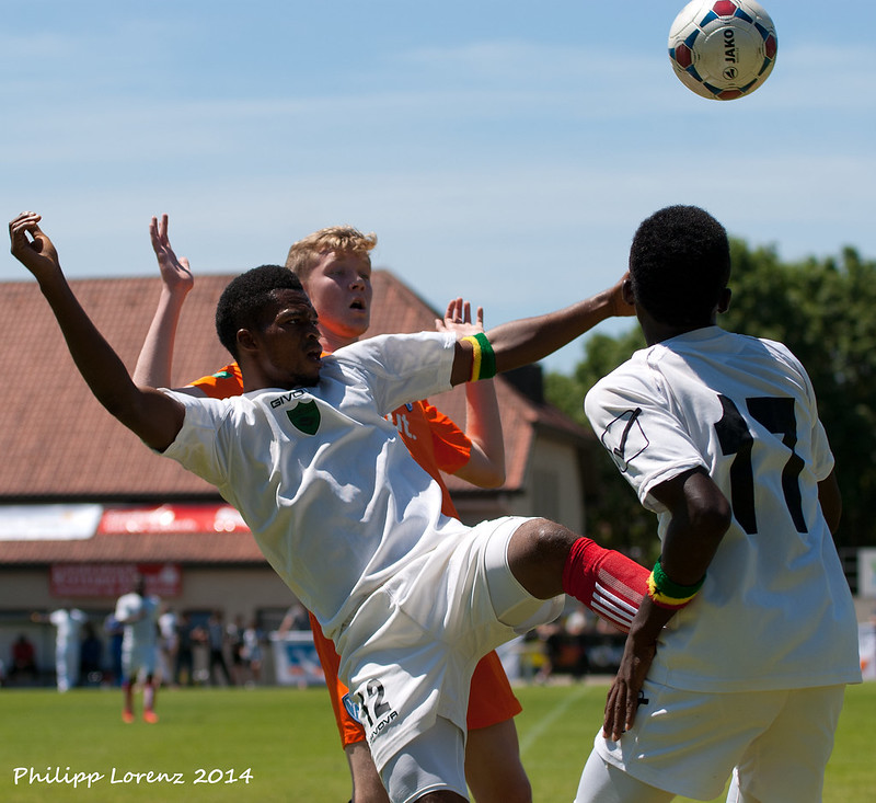Legs up and fighting for the ball