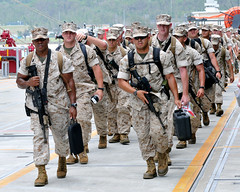 OKINAWA, Japan (June 27, 2011) – Marines of the 31st Marine Expeditionary Unit (MEU) walk down the pier at White Beach Naval Facility to embark the forward deployed amphibious assault ship USS Essex (LHD 2). (U.S. Navy Photo by Mass Communication Specialist 1st Class Terry Matlock/Released)