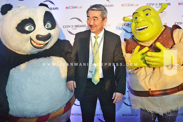DREAMWORKS' DREAMPLAY. As soon as Mr. Hans Sy saw the characters, he posed himself between them to be photographed.