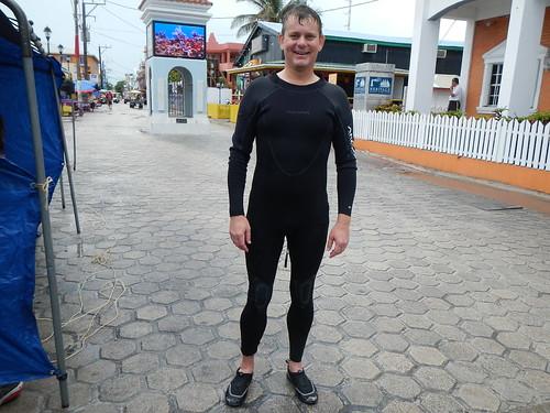 Erik in wetsuit on Front street San Pedro, smiling