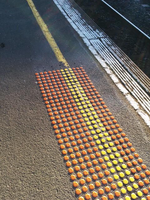 Old vs new: tactiles going in at #Bentleigh station this week.