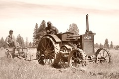 Willie and son, running an antique plow behind an antique Case tractor