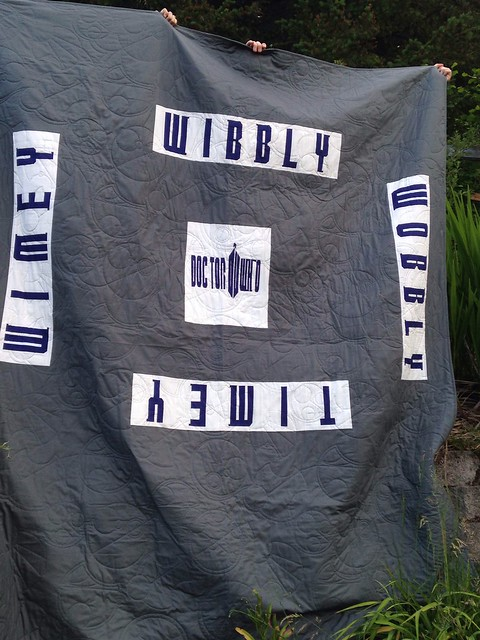 Doctor who along quilt is complete!  The back. Fantastic quilting by Christina Lane