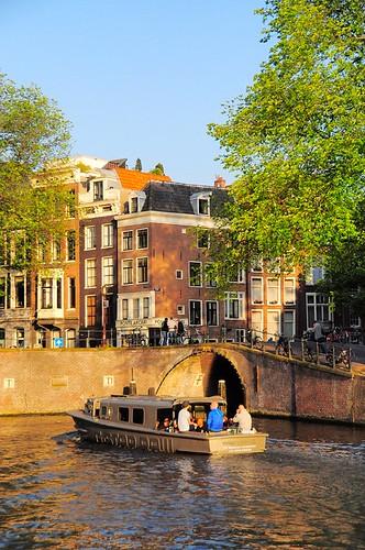 street travel sunset holland water netherlands amsterdam boat canal snapshot boating 0123 streetshot 随拍 荷兰 阿姆斯特丹