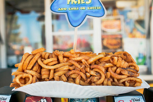 Log of curly fries. Street Food at Pima county fair by Photographer Jackie Alpers