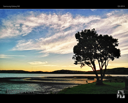 sunset sky sun tree water clouds reflections hills inlet nx metrosideros excelsa tomraven samsungnx aravenimage galaxynx q22014