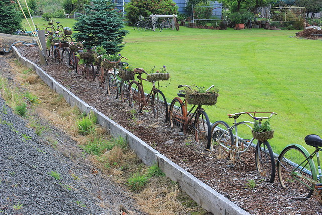 Flower Baskets On Fence : The bicycle fence and flower baskets flickr photo sharing
