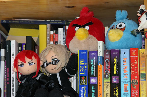 assassins and angry birds: plushies on my office shelves