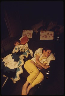 Children sleeping in one of the chair cars on the Southwest Limited, an overnight train from Los Angeles, California, to Albuquerque, New Mexico, June 1974