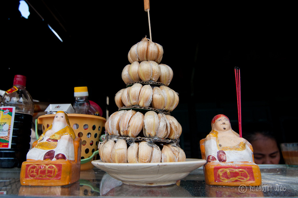 Garlic Shrine with a cigarette bud on the top