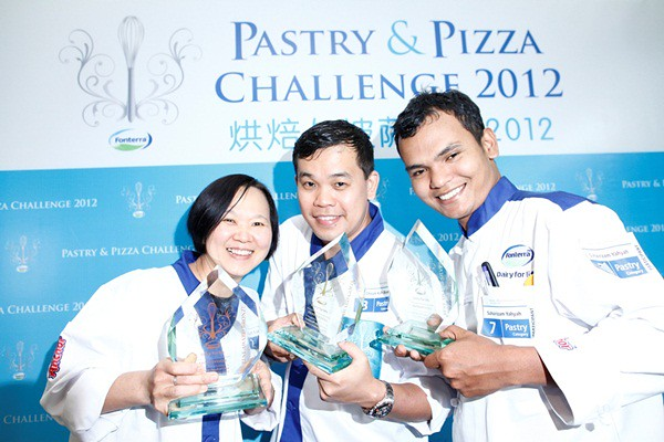 Fonterra FS Pic7 Fonterra Foodservices Pastry and Pizza Challenge, Pastry Category Winners, from left, Keat Ean Ean (Bronze), Cheam Kah Boon (Gold) and Suharizam Yahyah (Silver)