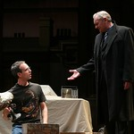 John (John Judd, r.) gives a gift to Ian (Jay Whittaker) in the Huntington Theatre Company's production of Shining City, written by Conor McPherson and directed by Robert Falls. Part of the 2007-2008 season.