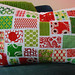a mini ticker tape christmas pillow