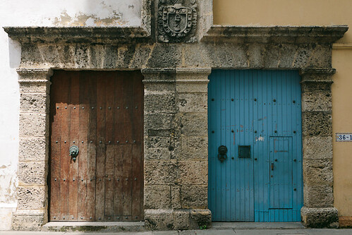 door wood blue red stone wall colombia closed bolivar symmetry number cartagena